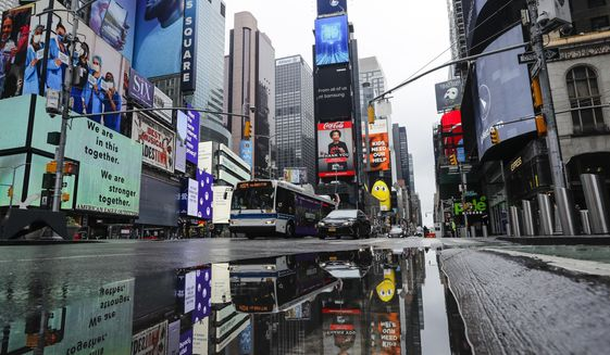 Vehicles move through a nearly empty Times Square during the coronavirus pandemic, Saturday, May 23, 2020, in New York. (AP Photo/Frank Franklin II)
