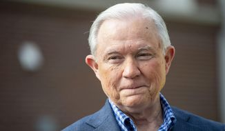 In this March 3, 2020, file photo Jeff Sessions talks with the media after voting in Alabama's primary election in Mobile, Ala. Mr. Sessions squares off against rival Tommy Tuberville in a runoff primary election to be held July 14. The winner will be the GOP nominee to challenge incumbent Democratic U.S. Sen. Doug Jones in the November general election.  (AP Photo/Vasha Hunt, File)  **FILE**