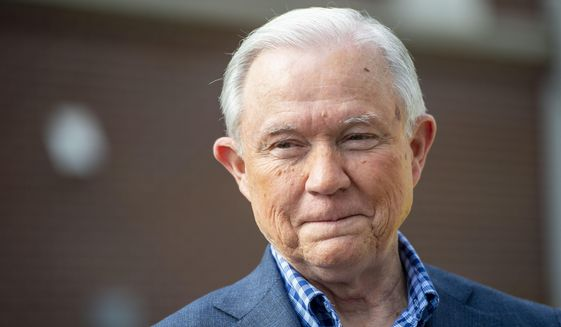 In this March 3, 2020, file photo Jeff Sessions talks with the media after voting in Alabama's primary election in Mobile, Ala. Mr. Sessions squares off against rival Tommy Tuberville in a runoff primary election to be held July 14. The winner will be the GOP nominee to challenge incumbent Democratic U.S. Sen. Doug Jones in the November general election.  (AP Photo/Vasha Hunt, File)  ** FILE **