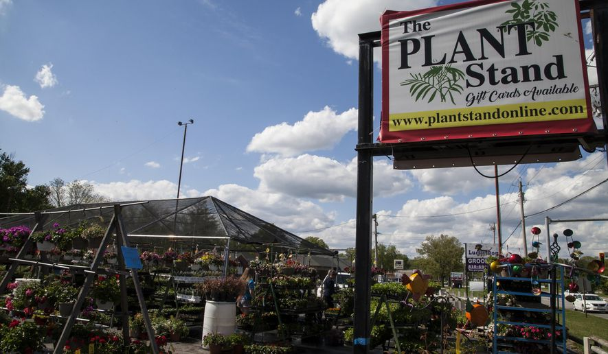 This May 7, 2020  photo shows The Plant Stand, located at 3110 Godfrey Road in Godfrey, IIl. Local garden centers are seeing more sales than ever this spring compared to years prior, as many residents are taking the opportunity while sheltering-in-place to spruce up their outdoor spaces. (Jeanie Stephens/The Telegraph via AP)