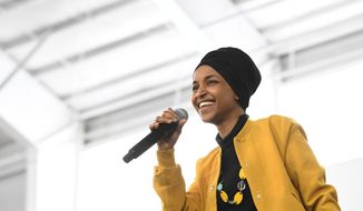 In this Feb. 29, 2020, file photo, U.S. Rep. Ilhan Omar, D-Minn., speaks at a rally in Springfield, Mass. At a young age, Rep. Omar earned a reputation as a fighter -- a bit of a misfit who saw fighting as a way to survive and earn respect. In her new memoir being released Tuesday, May, 26, 2020. Omar provides details about her life, as she went from a refugee and immigrant to congresswoman for Minnesota. (AP Photo/Susan Walsh File)