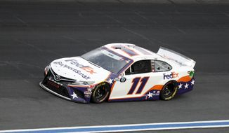 Denny Hamlin drives during the NASCAR Cup Series auto race at Charlotte Motor Speedway Sunday, May 24, 2020, in Concord, N.C. (AP Photo/Gerry Broome)  **FILE**