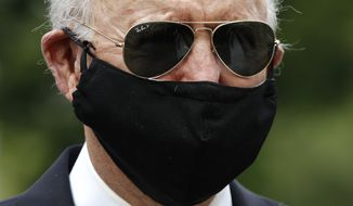 Democratic presidential candidate, former Vice President Joe Biden wears a face mask to protect against the spread of the new coronavirus as he and Jill Biden depart after placing a wreath at the Delaware Memorial Bridge Veterans Memorial Park, Monday, May 25, 2020, in New Castle, Del. (AP Photo/Patrick Semansky)