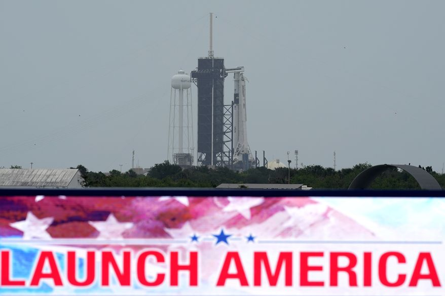 The SpaceX Falcon 9, with the Crew Dragon spacecraft on top of the rocket, sits on Launch Pad 39-A Monday, May 25, 2020, at Kennedy Space Center, Fla. Two astronauts will fly on the SpaceX Demo-2 mission to the International Space Station scheduled for launch on May 27. (AP Photo/David J. Phillip)