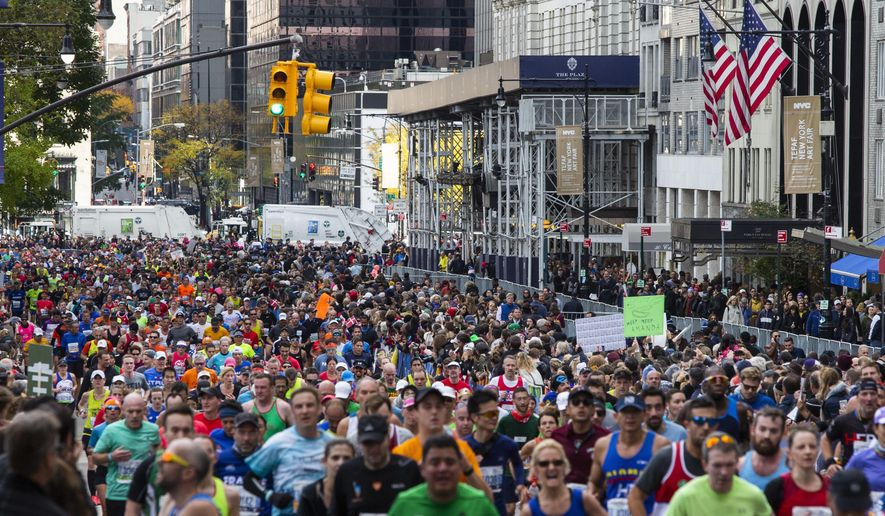 FILE - In this Nov. 3, 2019, file photo, runners take part in the New York City Marathon in New York. Non-profit organizations across the country are scrambling to keep their causes front of mind in the middle of the COVID-19 pandemic. Social distancing measures brought on by the coronavirus have forced non-profits that use participatory events like charity walks and runs as fundraisers are getting creative. (AP Photo/Eduardo Munoz Alvarez, File)