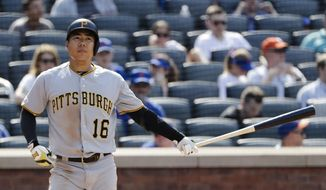 FILE - In this July 28, 2019, file photo, then Pittsburgh Pirates' Jung Ho Kang, of South Korea, reacts after striking out during the eighth inning of a baseball game against the New York Mets, in New York. The Korean Baseball Organization has suspended ex-Pittsburgh Pirates infielder Jung Ho Kang for a year and ordered him to perform 300 hours of community service over a series drunk driving cases.(AP Photo/Frank Franklin II, File)