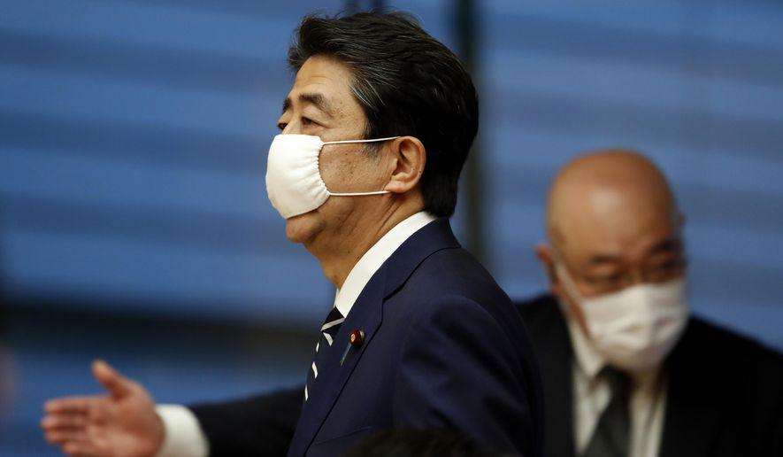 https://twt-thumbs.washtimes.com/media/image/2020/05/25/virus_outbreak_japan_50767_c0-168-5000-3083_s885x516.jpg?3dac12c5bacfc97f2090aafc3913bd4e1fb1050a