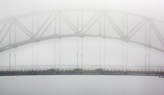 Light traffic crosses the Cape Cod Canal on the usually busy Sagamore Bridge, Monday, May 25, 2020, in Bourne, Mass. (AP Photo/Michael Dwyer)