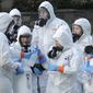 A disaster recovery team in protective suits and respirators prepare to treat a site of coronavirus outbreak in Washington state. A German report addresses the possibility of a terrorist attack using bioweapons. (Associated Press)