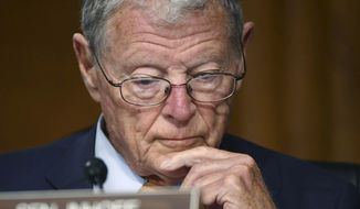 Sen. James Inhofe, R-Okla., listens during a Senate Environment and Public Works Committee oversight hearing to examine the Environmental Protection Agency, Wednesday, May 20, 2020, on Capitol Hill in Washington. (Kevin Dietsch/Pool via AP) **FILE**