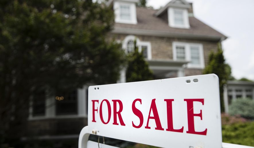 FILE- In this June 8, 2018, file photo a for sale sign stands in front of a house, in Jenkintown, Pa.  U.S. home prices accelerated in March 2020 even though sales plummeted, as those Americans still buying bid for a sharply diminished supply of homes. (AP Photo/Matt Rourke, File)
