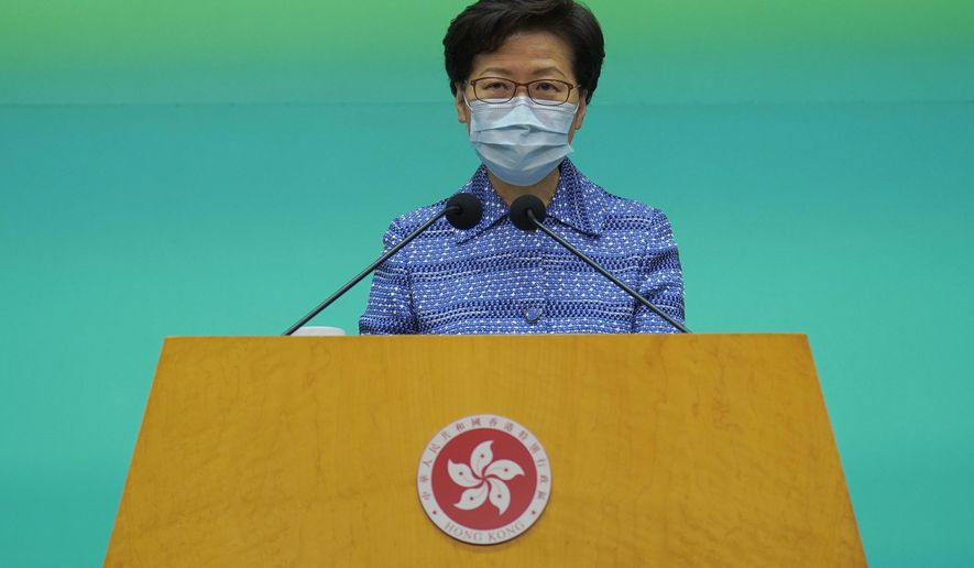Hong Kong Chief Executive Carrie Lam listens to reporters' questions during a press conference in Hong Kong, Tuesday, May 26, 2020. Lam tried again Tuesday to defend a new national security law that China's parliament is going to impose on Hong Kong. (AP Photo/Vincent Yu)