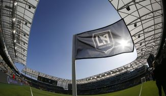FILE - In this April 29, 2018 file photo taken with a fisheye lens, a flag flies at the Banc of California Stadium prior to an MLS soccer game between Los Angeles FC and the Seattle Sounders in Los Angeles. Los Angeles FC will seek a new name for its 2-year-old Banc of California Stadium after a restructuring of the bank's partnership with the Major League Soccer club. LAFC announced Tuesday, May 26, 2020 that Banc of California will eventually give up its naming rights to the sleek new stadium just south of downtown Los Angeles. (AP Photo/Ringo H.W. Chiu, file)