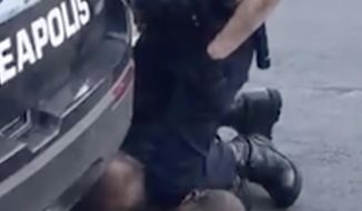 In this Monday, May 25, 2020 frame from video provided by Darnella Frazier, Minneapolis police officer Dereck Chauvin kneels on the neck of George Floyd, a handcuffed man who was pleading that he could not breathe. (Darnella Frazier via AP)  **FILE**