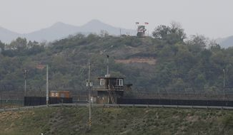 In this May 3, 2020, file photo, military guard posts of North Korea, rear, and South Korea, bottom, are seen in Paju, at the border with North Korea, South Korea. A U.N. investigation into a recent exchange of gunfire between the two Koreas has determined that both countries violated the armistice that ended the 1950-53 Korean War, the American-led U.N. Command said Tuesday, May 26. (AP Photo/Ahn Young-joon, File)