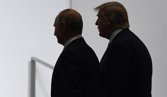 In this June 28, 2019, photo, President Donald Trump and Russian President Vladimir Putin walk to participate in a group photo at the G-20 summit in Osaka, Japan. (AP Photo/Susan Walsh/File)