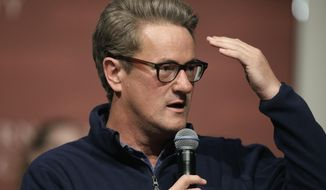 In this Oct. 11, 2017, file photo, MSNBC television anchor Joe Scarborough takes questions from an audience at forum at the John F. Kennedy School of Government, on the campus of Harvard University, in Cambridge, Mass.   (AP Photo/Steven Senne, File)