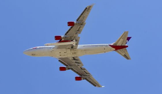 A Virgin Orbit Boeing 747-400 aircraft named Cosmic Girl takes off from Mojave Air and Space Port in the desert north of Los Angeles Monday, May 25, 2020. Richard Branson's Virgin Orbit failed Monday in its first test launch of a new rocket carried aloft by the Boeing 747 and released over the Pacific Ocean off the coast of Southern California. (AP Photo/Matt Hartman)