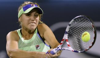 In this Feb. 18, 2020, file photo, Sofia Kenin returns the ball to Kazakhstan's Elena Rybakina during a match of the Dubai Duty Free Tennis Championship in Dubai, United Arab Emirates. If World TeamTennis gets its way, Grand Slam champions Sofia Kenin and Sloane Stephens could be among the first tennis players to compete in front of fans after the coronavirus pandemic prompted lockdowns around the globe. WTT said Tuesday, May 26, 2020, it is planning to allow up to 500 spectators at each of its outdoor matches during a three-week season from July 12 to Aug. 2 at a resort in West Virginia.(AP Photo/Kamran Jebreili, File)  **FILE**