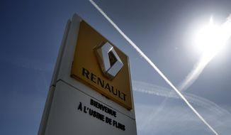 The logo of French carmaker Renault is pictured at the Flins plant of French carmaker Renault in Aubergenville, west of Paris, Monday, May 25, 2020. French President Emmanuel Macron is set to unveil sweeping new measures to rescue France's car industry, hammered by virus lockdown and the resulting recession. The issue is politically sensitive, since France is proud of its auto industry, which employs 400,000 people and is an important part of the country's remaining manufacturing sector. (AP Photo/Christophe Ena)