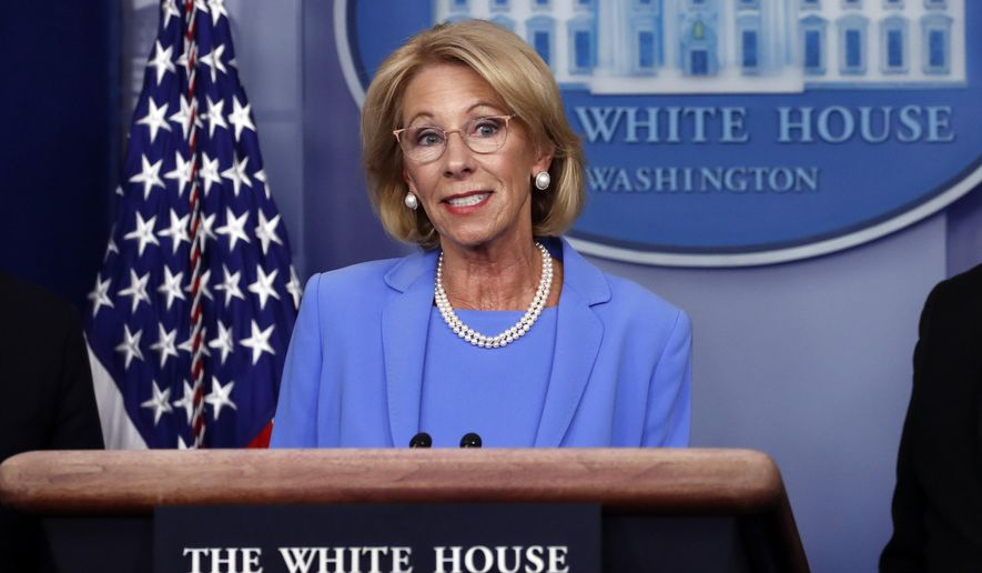 Education Secretary Betsy DeVos speaks about the coronavirus in the James Brady Press Briefing Room, Friday, March 27, 2020, in Washington. (AP Photo/Alex Brandon)