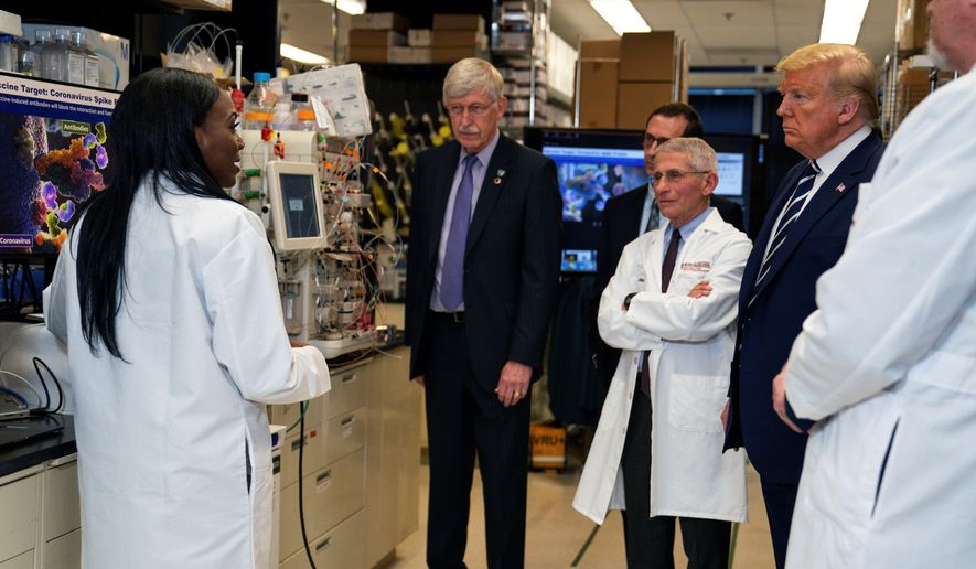 Kizzmekia Corbett (left) accompanied President Trump on a tour in early March of the Viral Pathogenesis Laboratory at the National Institutes of Health. (Associated Press/File)