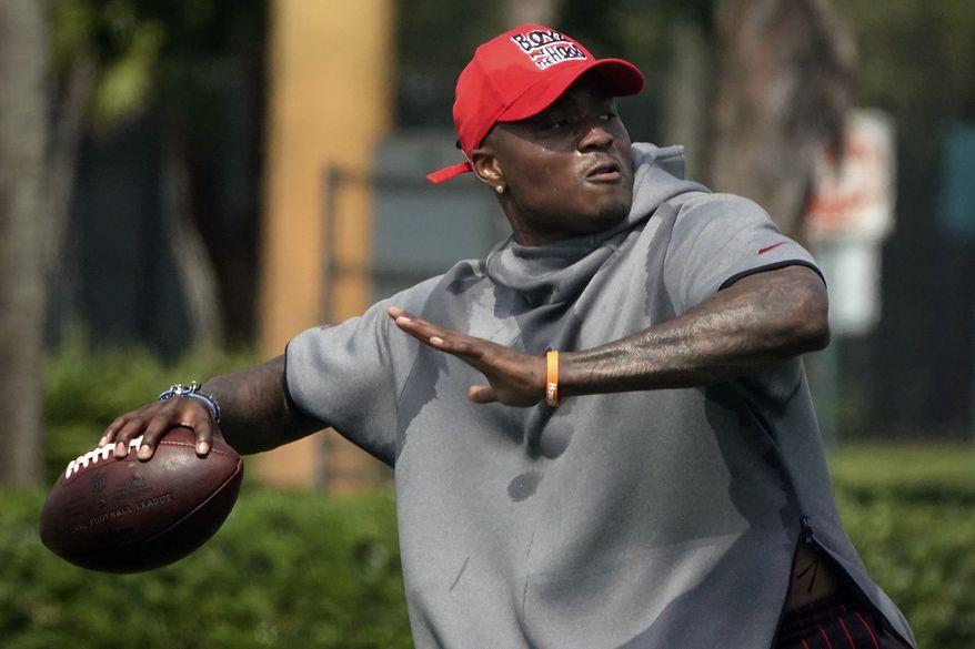 Washington Redskins NFL football quarterback Dwayne Haskins throws a pass, Wednesday, May 27, 2020, at Holiday Park in Fort Lauderdale, Fla. (Joe Cavaretta/South Florida Sun-Sentinel via AP)  **FILE**