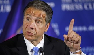 """Wearing a bracelet that says """"NY Tough,"""" New York Gov. Andrew Cuomo speaks during a news conference, Wednesday, May 27, 2020, at the National Press Club in Washington. (AP Photo/Jacquelyn Martin)"""