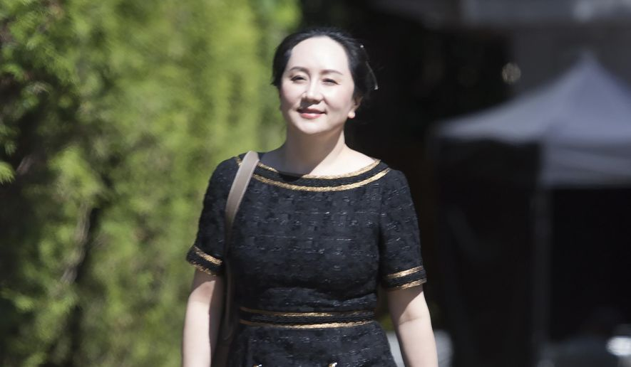 Meng Wanzhou, chief financial officer of Huawei, leaves her home to go to British Columbia Supreme Court in Vancouver, Wednesday, May 27, 2020.  A Canadian judge ruled Wednesday the U.S. extradition case against Meng can continue to the next stage.  (Jonathan Hayward/The Canadian Press via AP)