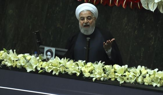 Iranian President Hassan Rouhani speaks during the inauguration of the new parliament in Tehran, Iran, Wednesday, May, 27, 2020. Iran convened its newly elected parliament, dominated by conservative lawmakers and under strict social distancing regulations, as the country struggles to curb the spread of coronavirus that has hit the nation hard. Iran is grappling with one of the deadliest outbreaks in the Middle East. (AP Photo/Vahid Salemi) **FILE**