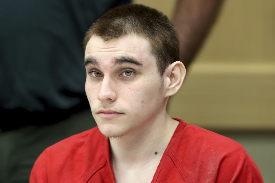FILE - In this Dec. 10, 2019 Nikolas Cruz appears at a hearing in Fort Lauderdale on Tuesday, Dec. 10, 2019. A mental health provider cannot be held liable for the actions of the man accused of a 2018 Florida high school massacre, an appeals court ruled Wednesday, May 27, 2020. Henderson Behavioral Health Inc. treated Nikolas Cruz off and on from 2009 to 2016, court records show. (Amy Beth Bennett/South Florida Sun Sentinel via AP, Pool)