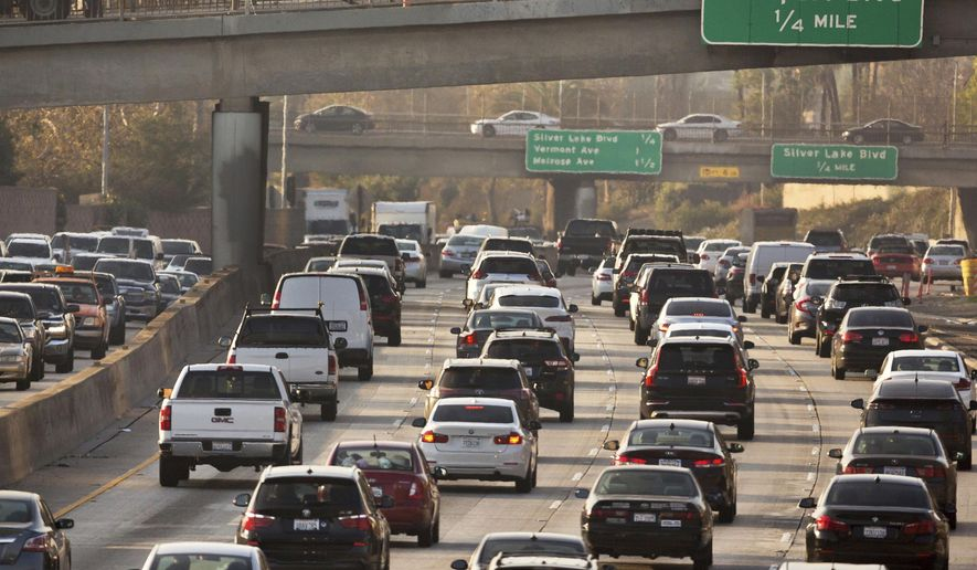 In this Dec. 12, 2018, photo, traffic moves on the Hollywood Freeway in Los Angeles. (AP Photo/Damian Dovarganes) **FILE**