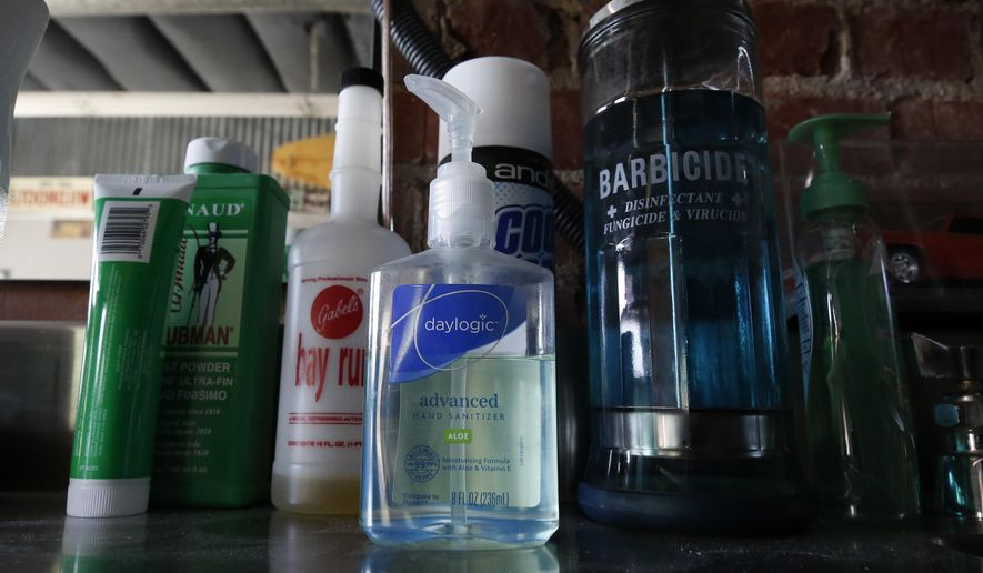 In this file photo, hand sanitizers sit among other items in the East J Barbershop in Sacramento, Calif., Wednesday, May 27, 2020. The New Mexico state Department of Health says there have been three fatalities since May from state residents fatally ingesting hand sanitizer. Three others were hospitalized in critical condition and one person was reportedly permanently blinded.  (AP Photo/Rich Pedroncelli)  **FILE**