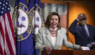 House Speaker Nancy Pelosi of Calif., with House Majority Whip James Clyburn of S.C., back right, speaks during a news conference on Capitol Hill, Wednesday, May 27, 2020, in Washington. (AP Photo/Manuel Balce Ceneta)