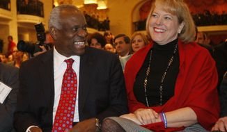Supreme Court Justice Clarence Thomas sits with his wife Virginia Thomas in Washington.  (AP Photo/Charles Dharapak, File)