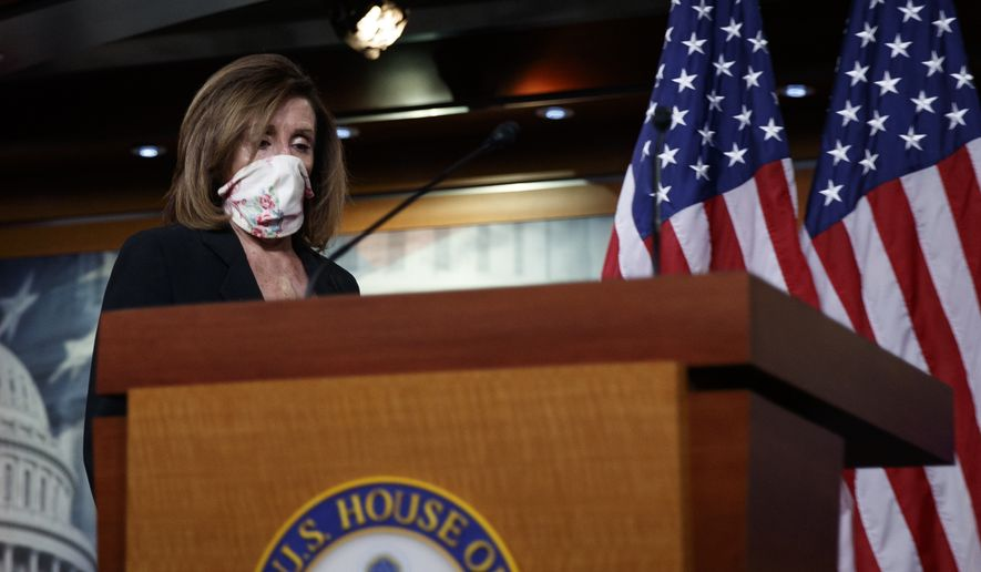 House Speaker Nancy Pelosi of Calif., wears a face mask as she arrives to speaks at a news conference on Capitol Hill in Washington, Thursday, May 28, 2020. (AP Photo/Carolyn Kaster)