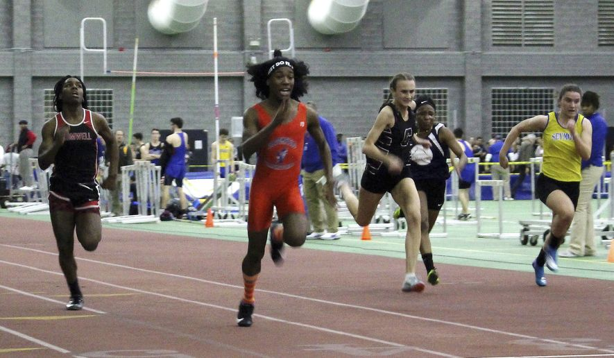 Bloomfield High School transgender athlete Terry Miller, second from left, wins the final of the 55-meter dash over transgender athlete Andraya Yearwood, far left, and other runners in the Connecticut girls Class S indoor track meet at Hillhouse High School in New Haven, Connecticut, Feb. 7, 2019. The U.S. Education Department's Office for Civil Rights has found a Connecticut policy that allows transgender athletes to compete in girls sports is illegal. The office says the policy violates Title IX, the federal civil rights law that guarantees equal education opportunities for women, including in athletics.  (AP Photo/Pat Eaton-Robb) ** FILE **