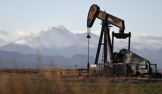 This Dec. 22, 2018, file photo shows a pump jack over an oil well along Interstate 25 near Dacono, Colo. (AP Photo/David Zalubowski, File)