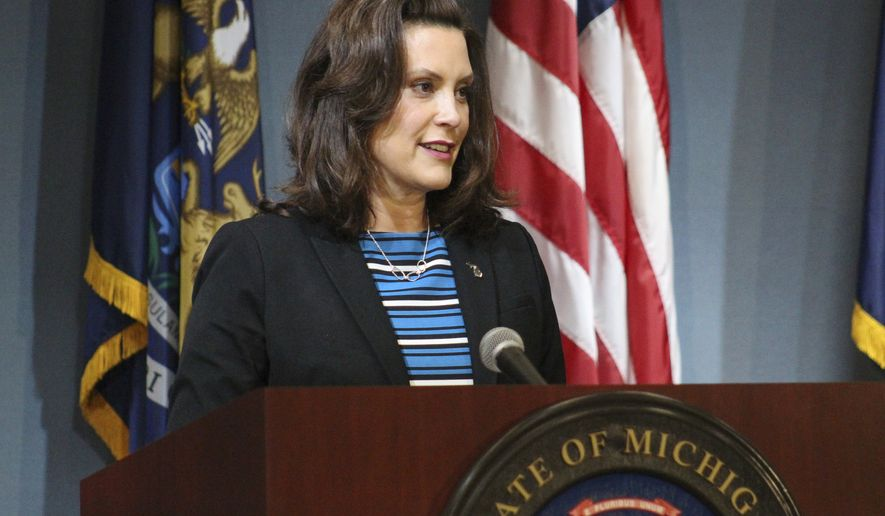 In this photo provided by the Michigan Executive Office of the Governor, Gov. Gretchen Whitmer speaks during a news conference Thursday, May 28, 2020, in Lansing, Mich. Whitmer urged the federal government to give the state more flexibility to spend coronavirus rescue aid to fill budget shortfalls and to pass another round of relief funding. (Michigan Executive Office of the Governor via AP)
