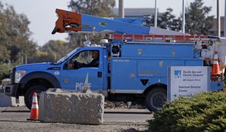 FILE - In this Feb. 11, 2020, file photo, a Pacific Gas & Electric truck leaves the company's Oakland Service Center in Oakland, Calif. PG&E's chief financial officer, Jason Wells, is expected to face questions Thursday, May 28 about the company's plan to nearly double its debt to almost $40 billion to finance its payments to wildfire victims, insurers and government agencies in the second day of the company's bankruptcy trial. Meanwhile, the Public Utilities Commission will vote on the bankruptcy plan. (AP Photo/Ben Margot, File)
