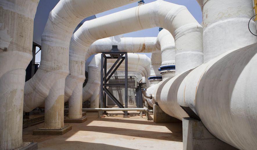 """FILE - In this May 4, 2014 file photo, shows the Sorek desalination plant in Rishon Letzion, Israel. The national cyber chief Thursday, May 28, 2020, officially acknowledged Israel had thwarted a major cyber attack last month against its water systems, an assault widely attributed to arch-enemy Iran, calling it a """"synchronized and organized attack"""" aimed at disrupting key national infrastructure. (AP Photo/Dan Balilty, File)"""