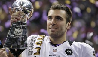 FILE - In this Feb. 13, 2013 file photo, Baltimore Ravens quarterback Joe Flacco (5) holds the Vince Lombardi Trophy after defeating the San Francisco 49ers 34-31 in the NFL Super Bowl XLVII football game in New Orleans. Flacco was the Super Bowl MVP and the NFL's highest-paid quarterback just a few years ago. After injuries shortened his last two seasons, Flacco is now in New York with a new role: as a backup to Sam Darnold.  (AP Photo/Matt Slocum, File)