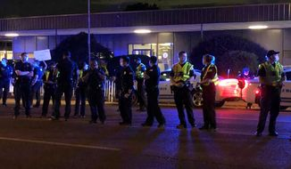 Officers form a line in front of a police precinct Wednesday, May 27, 2020, in Memphis, Tenn., during a protest over the death of George Floyd in police custody earlier in the week in in Minneapolis. (AP Photo/Adrian Sainz)