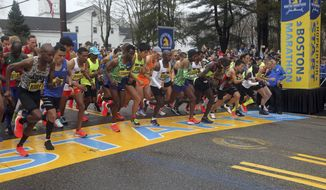 In this April 15, 2019, file photo, the elite men break from the start of the 123rd Boston Marathon in Hopkinton, Mass. The 2020 Boston Marathon, which was rescheduled to run on Sept. 14th, was canceled Thursday, May 28, 2020, for the first time in its 124-year history due to the COVID-19 virus outbreak. (AP Photo/Stew Milne, File)