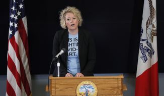 Iowa Department of Public Health Deputy Director Sarah Reisetter updates the state's response to the coronavirus outbreak during a news conference at the State Emergency Operations Center, Thursday, May 28, 2020, in Johnston, Iowa. (AP Photo/Charlie Neibergall, pool)