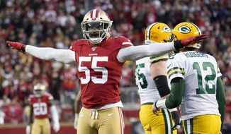 """FILE - In this Sunday, Jan. 19, 2020 file photo, San Francisco 49ers defensive end Dee Ford (55) gestures next to Green Bay Packers quarterback Aaron Rodgers (12) during the first half of the NFL NFC Championship football game in Santa Clara, Calif. San Francisco edge rusher Dee Ford had an """"extensive cleanup"""" operation for tendinitis in his left knee that limited his effectiveness in his first season with the 49ers. Ford said Friday, May 29, 2020 that Dr. James Andrews performed the operation a few weeks after San Francisco lost the Super Bowl. (AP Photo/Tony Avelar, File)"""