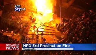 A fire rages in Minneapolis on May, 28, 2020, after arsonists set fire to the police department's 3rd Precinct building. (Image: Sky, CBS-4 Minnesota video screenshot)