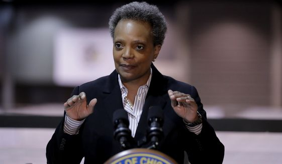 """In this April 10, 2020, photo Chicago Mayor Lori Lightfoot speaks during a news conference in Hall A at the COVID-19 alternate site at McCormick Place in Chicago. Lightfoot says President Donald Trump was aiming to """"inflame racist urges"""" when he threatened to take action against protesters in Minneapolis. Lightfoot was responding to a Trump tweet in which he wrote """"when the looting starts, the shooting starts"""" in response to violent protests over the death of George Floyd after a white police officer knelt on his neck. (AP Photo/Nam Y. Huh) **FILE**"""