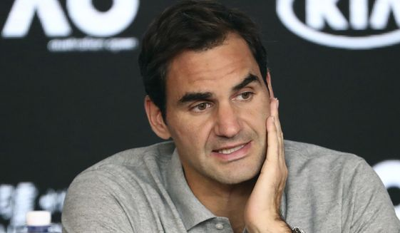 In this Jan. 30, 2020, file photo, Switzerland's Roger Federer speaks during a press conference following his semifinal loss to Serbia's Novak Djokovic at the Australian Open tennis championship in Melbourne, Australia. Federer leads the annual Forbes ranking of highest-paid athletes with what the magazine says is $106.3 million in total earnings. He is the first tennis player top the list since it was first compiled in 1990. (AP Photo/Dita Alangkara) ** FILE **