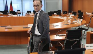 German Foreign Minister Heiko Maas attends the weekly cabinet meeting at the Chancellery in Berlin, Germany, Wednesday, May 20, 2020. (Fabrizio Bensch/Pool Photo via AP)
